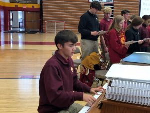 Anthony Higgins plays the piano at a Scecina school Mass.