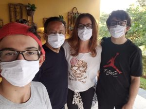 Lorenzo Bender pictured with his family, wearing masks