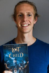 Andrew Clegg holding a copy of his book The Lost Child