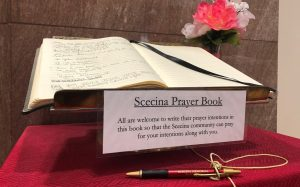 Scecina Prayer Book on stand with vase of flowers