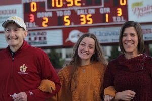 Scecina family at senior night - dad, daughter, mom