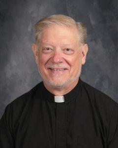 Headshot of Father Rick